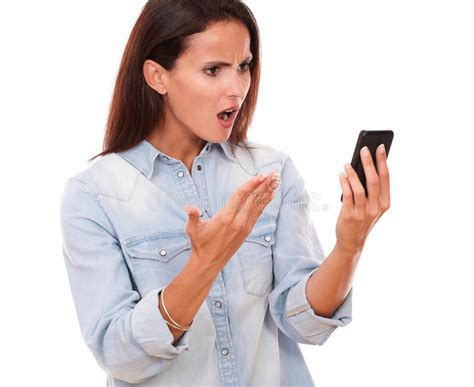 Angry Adult Female Reading A Message Stock Photo