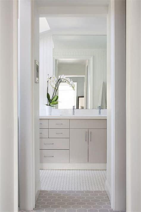 light gray flat front vanity cabinets  white quartz