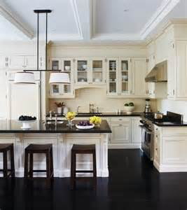 dark floors in the kitchen give depth to the cream
