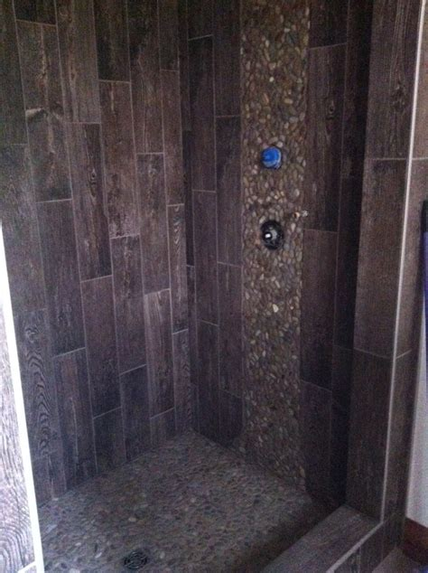 quot outhouse quot shower using 6x24 porcelain tile and pebble