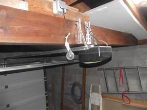 Mecanisme porte de garage sectionnelle for Mecanisme porte garage