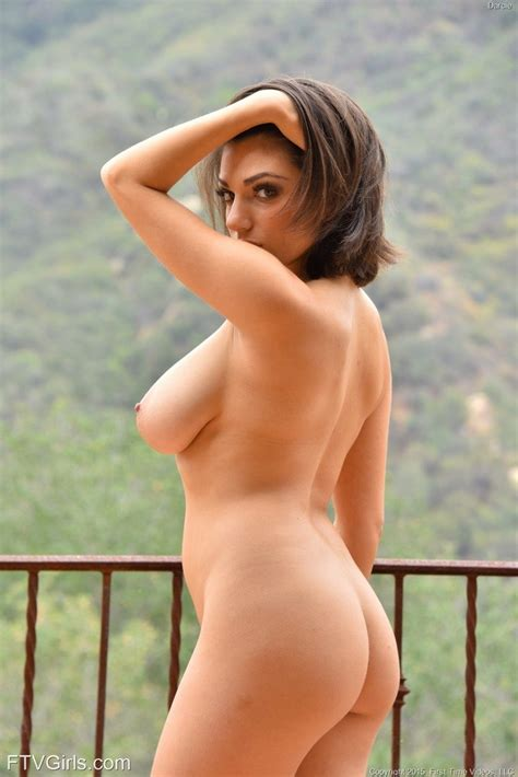 Busty Brunette Babe Darcie Dolce Removes Her Dress 1 Of 1