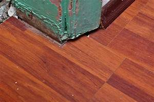 Lay laminate flooring effectively and beautifully your for How to lay laminate flooring through a doorway