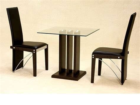 small clear square glass dining table and 2 chairs