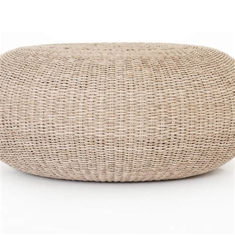 The coastal theme looks breezy and adds a fresh feel to a living room. Ivonne Coastal Beach Round White Wash Woven Wicker Outdoor Coffee Table