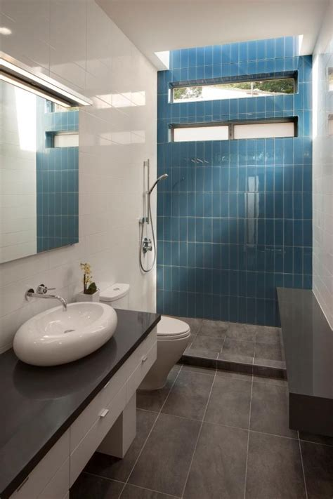 blue tile accent wall modern bathroom  polished white