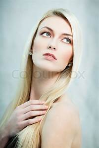 Fashion Portrait Of Blond Lady Looking Up Stock Photo