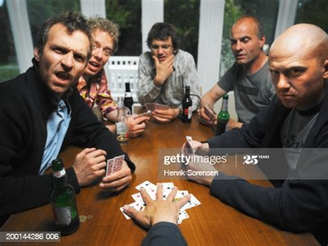 men  table  drinks playing cards portrait high res