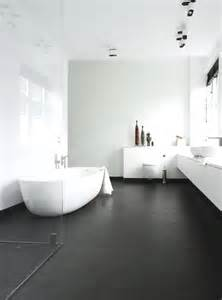 White Bathroom with Dark Floors and Walls