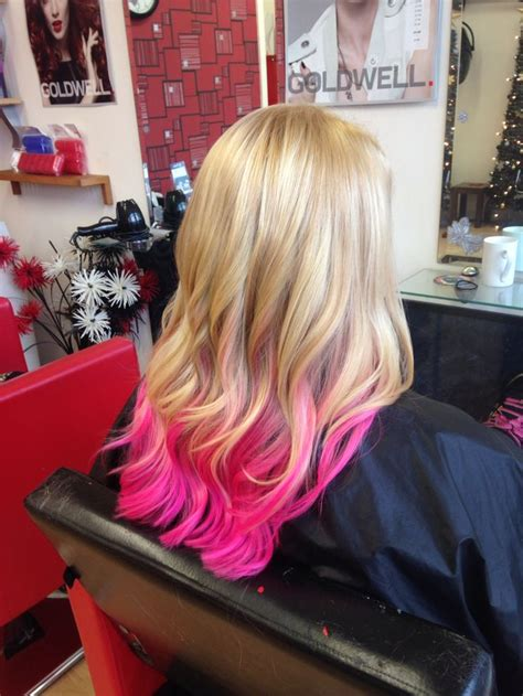 Blonde Hair With A Pink Ombré On The Length Finished With