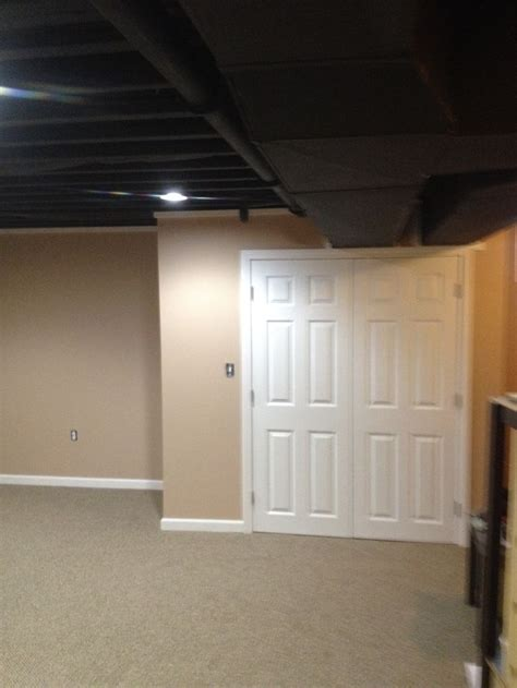 exposed basement ceiling  spray painted black due