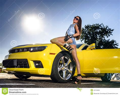 sport cars with girls luxury glamour and yellow sport car stock image
