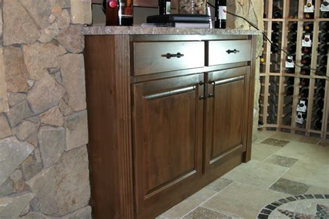 wine room cabinet with granite top