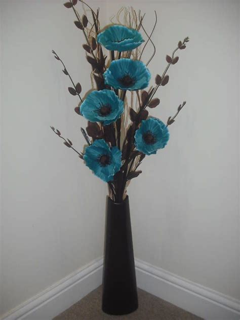 teal silk flower arrangement black vase  metre tall
