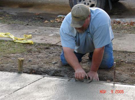 local concrete contractors driveway repair pour patio