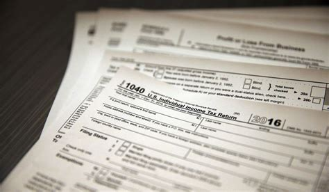 irs help desk in this jan 14 2017 photo tax forms sit on a desk at