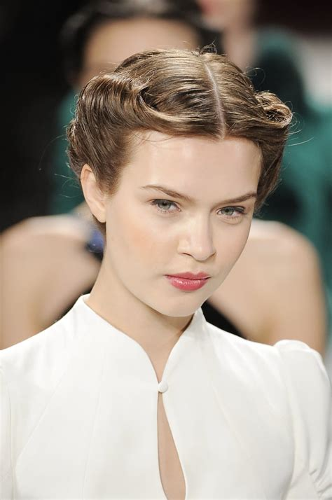 Cool Hairstyles For 40 by A Chic 40s Style Rolled Updo Kept The Hair The