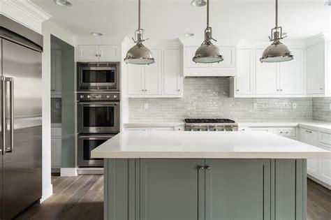 white kitchen  grey island transitional bathroom