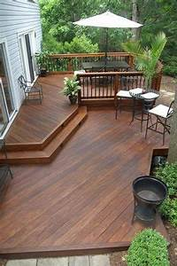 great wood patio design ideas Create a safe but open wood deck design using a multi-level plan with rails only where necessary ...
