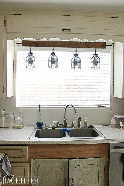 kitchen lights above sink lighting above kitchen sink inspiration 5375