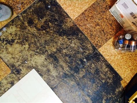 asbestos in tile and mastic and air buying a house