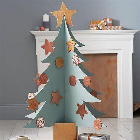 la decoracion de navidad se viste de carton cuaderno