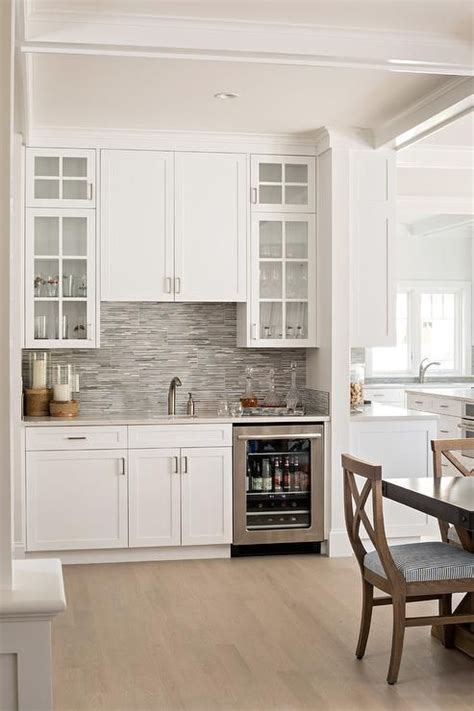 built  dining room wet bar features white shaker