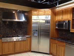 antique white kitchen island corner fridge with stove to left kitchen