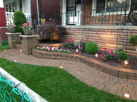 raised landscape beds raised flower bed with decorative stone and a japanese maple by sandstone landscaping llc