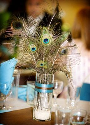 Hmmmm peacock feather centerpieces or flowers with