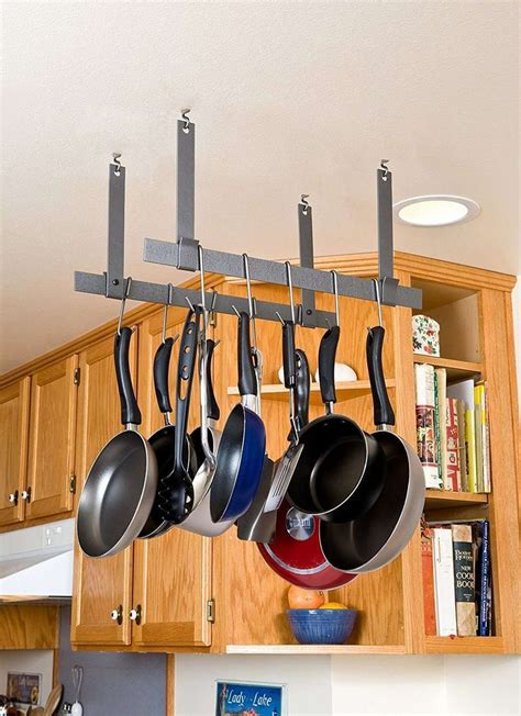 17 best ideas about hanging pots kitchen on pot rack hanging pot and pan lids and