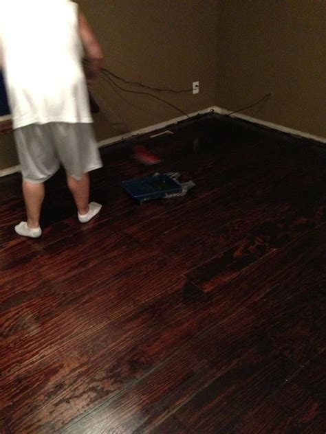 lowes flooring plywood plywood floors 8 quot wide planks cut by the helpful dudes at lowes sanded stained with red