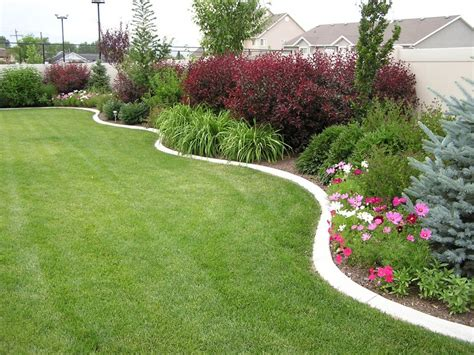 pictures of landscaped yards landscaping in a curved bed along a privacy wall may be a perfect idea for the back yard