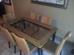 simple dining table with rectangle clear glass top and