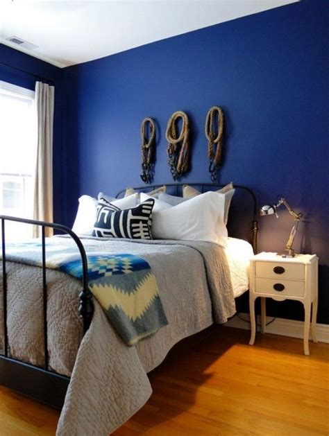 antique metal bed and navy blue wall color for amazing