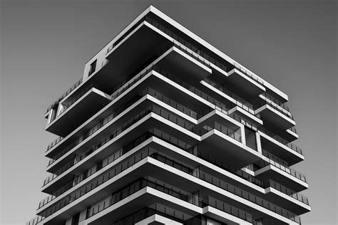 Grayscale Photo Of Concrete Building · Free Stock Photo