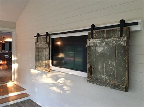Shiplap Wall Hanging by Rustic Barn Doors Used To Hide Wall Mounted Tv On Ship