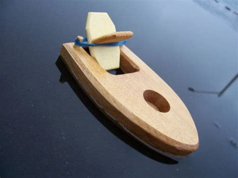 toy bathtub boat  rubber band powered paddle  hecllc