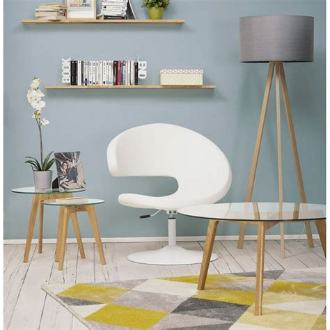 Curved metal legs are topped with a piece of tempered glass. Scandinavian round coffee table with tempered glass top LILY