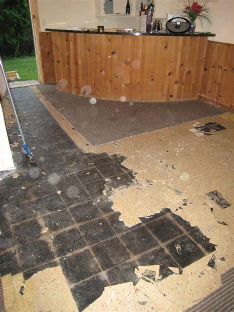 remove black mastic  wood floor holiday hours