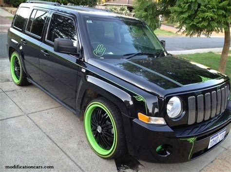 open jeep modified in black colour color jeep patriots modified jeep patriot with a green