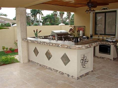 white rendered outdoor kitchen with inset tile