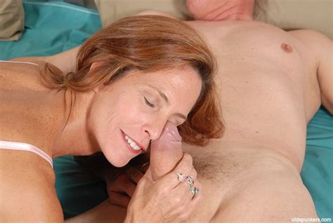 Stunning Redhead Mature Sherry Gives A Blowjob And Gets