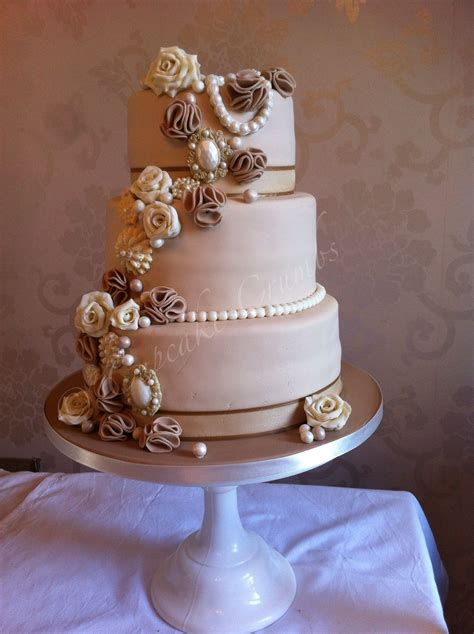 vintage style wedding cake with broaches pearls ruffles