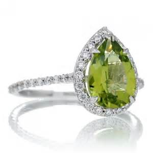 peridot wedding rings peridot engagement ring 10x7 pear halo band