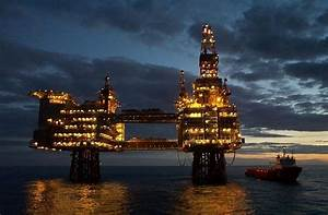 oil drilling rig at night http://business-directory ...