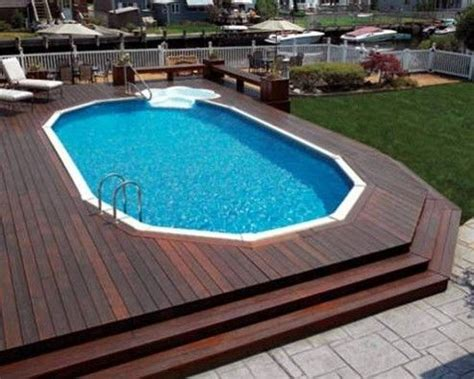 oval shaped above ground pool with deck here you go stacey outside oasis