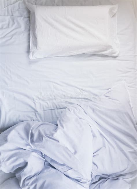 pillow top mattress white unmade bed mattress duvet with pillow and blanket