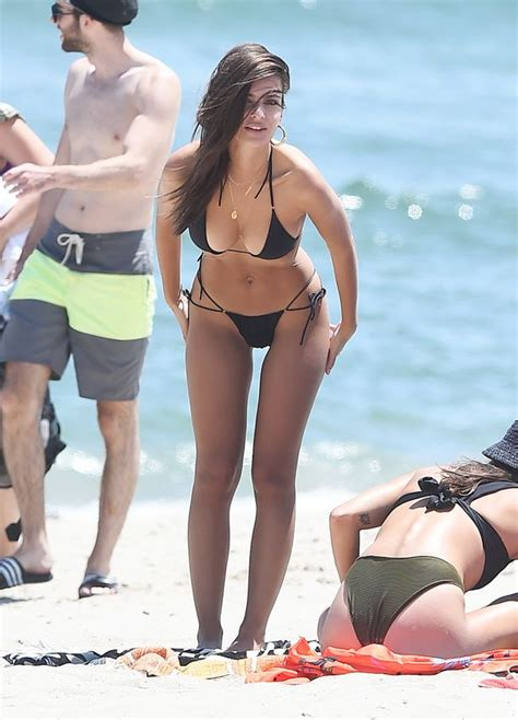 Emily Ratajkowski showcases amazing abs and cleavage in ...