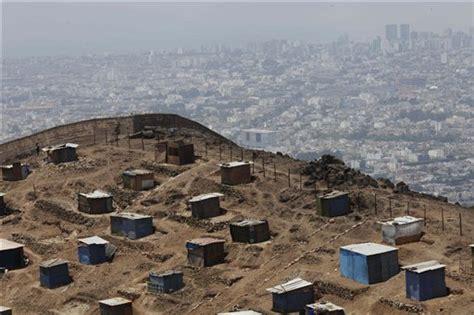 homes built into hillside peru 39 s capital highly vulnerable to major quake
